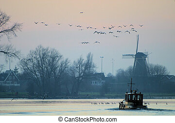 Evening falls in Holland. River view