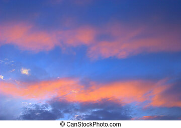 Sky with blue and orange clouds taken at sunset after a...