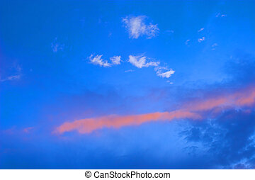 Sky Blue - Blue sky with orange and white clouds at sunset
