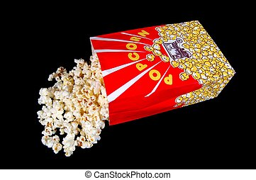Popcorn Bag - A popcorn bag and popcorn on a black...