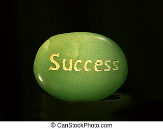 Success Lit up - Green stone carved with the word success...