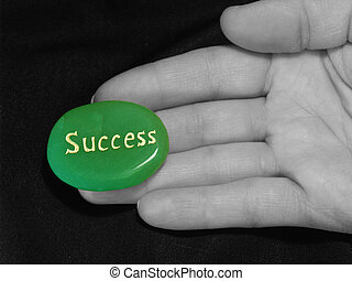 Success at Fingertip - Green stone engraved with the word...