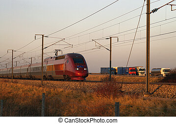 Trains and Trucks - High speed TGV train in France passing...