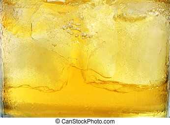 Whiskey Background - Whiskey in tumbler with ice; background