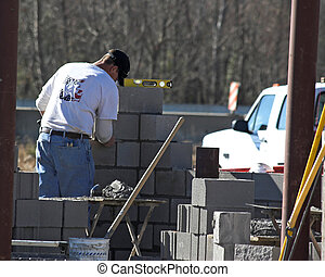 Mason at work - Contractors working on new construction
