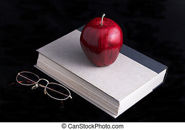 Apple book glasses - Apple,book glasses on black background...