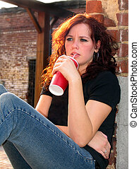 teen fast food drink - Young teen woman sipping fast food...