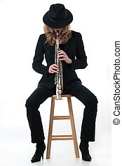 Lady saxophone player dressed in black over white background