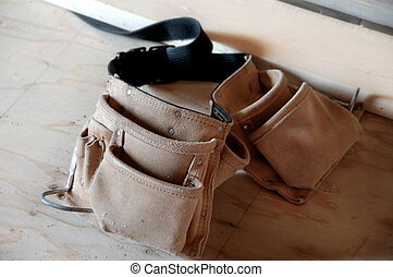 Carpenters Toolbelt - carpenters tool belt on plywood