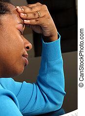 Headache - A young woman with a headache