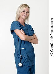 Pretty nurse with arms crossed smiling