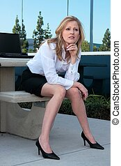 Business woman sitting outside
