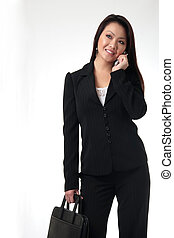 Attractive business woman talking on cell phone on white...