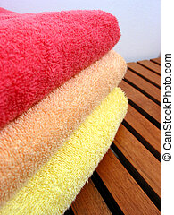 Towel stack 4 - Stack of bright colorful clean towels on a...