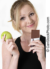 making the right choice - woman holding an apple and...