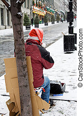 Homeless Man - Homeless man playing harmonica in montreal