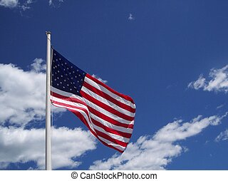 American flag and blue sky.