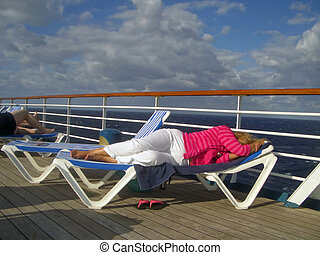 Tired Cruise Lady - A tired lady takes a nap on the deck of...