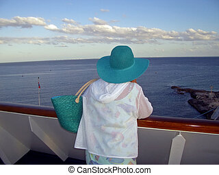 Turquoise Hat Cruise - A woman in a turquoise hat stands on...