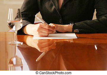 business agreement - woman signing a contract