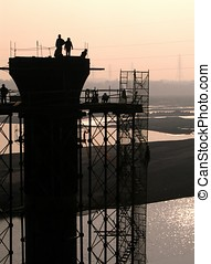 Bridge Construction - -- workers on a pier in a river in...