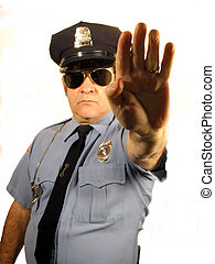 STOP - , a uniformed Police Officer holding his hand up in...