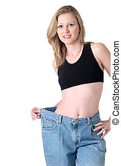 Woman demonstrating weight loss by wearing an old pair of...