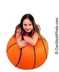 Over Ball - Young girl laying on big basketball