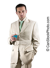 Businessman celebrating with a glass of drink in a white...