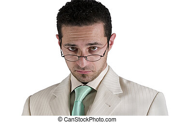 Businessman looking over his glasses - Isolated businessman...