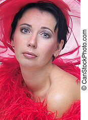 Lady in red hat - portrait of a beautiful young woman...