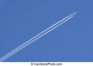 Vapour Trails - A jumbo jet flies through a perfect blue sky...