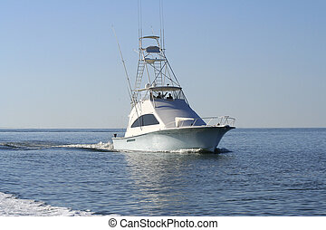 Sport Fishing Boat headed back to the Marina after a...