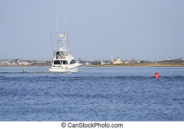 Sport Fishing Boat headed through Channel/Inlet