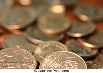 Jumble of Coins - Pile of coins in red light