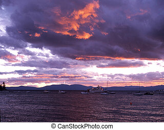 sunset on the cove - Zephyr Cove Nevada at sunset with boats...