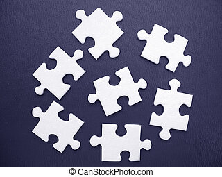 White jigsaw on a blue background