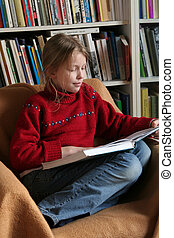Reading a book - A girls sitting and reading a book
