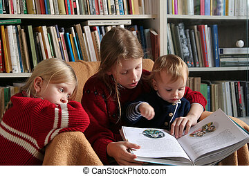 Lets read together - Three sisters reading a book