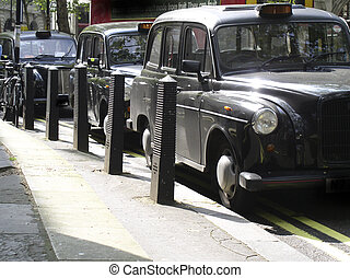 London taxis - Waiting for business on The Strand