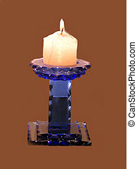 Candle blue holder - ,a lit candle in a blue holder,over...