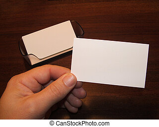 Business Cards 3 - Male hand holding a blank business card...