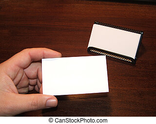 Business Cards 2 - Male hand holding blank business card...