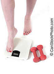 lady stepping on a bathroom scale with a set of three pound...