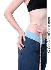 Woman measuring waist - woman measuring her waist...