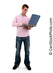 Teen Boy Computer - Full body shot of cute freckled male...