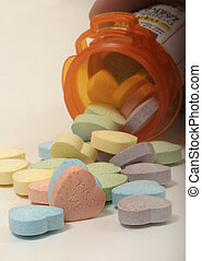 heart pills - candy heart pills poured out of a medication...