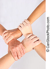 Interlock hands of four people