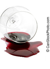 Spilt Red Wine - Red wine spilling from glass