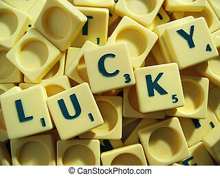 Feeling Lucky - Scrabble tiles in a pile with the word lucky...